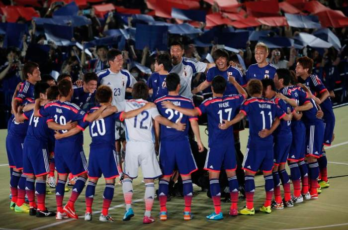 Japan national soccer team players huddle during a send-off ceremony for the World Cup Brazil, in Tokyo